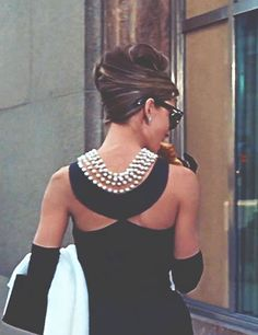 Holly Golightly in that iconic black Givenchy gown and pearl necklace.
