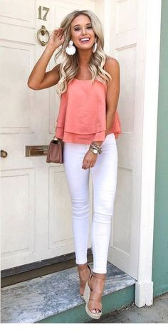 White pants and coral top