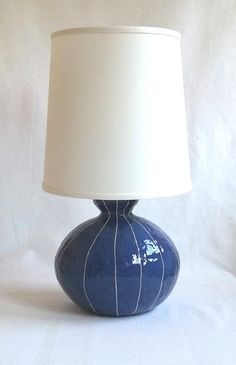 Plump gourd shape lamp base gives a cozy, slightly retro feel to a room. In Danish blue with white stripes from VIT ceramics