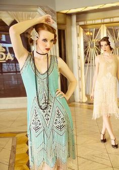 1920s inspired flapper dress. The dresses were very flowy and comfortable and had many tassels, the girls started showing off their legs. It gave a jazzy look.