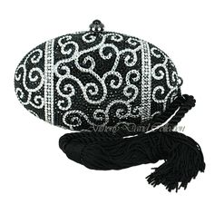 This beautiful oval egg shaped Anthony David black crystal evening bag has a solid metal frame that is fully covered with jet black Swarovski crystals. This evening purse is like a precious gem; ea...