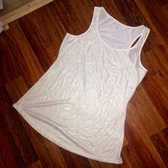 NWOT Maurices Basic Shimmer Tank NWOT NEVER WORN Maurice's Gold Shimmer Tank. Great basic tank with a slight gold shimmer. Base color is cream. Perfect for layering and has stretch to it. True to size! Maurices Tops Tank Tops