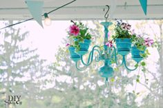 Spruce up your garden with these cheap and easy DIY garden ideas. From DIY planters to container gardening ideas, there are plenty of garden projects on a budget to choose from. Chandelier Planter, Old Chandelier, Flower Chandelier, Chandelier Ideas, Chandeliers, Outdoor Chandelier, Turquoise Chandelier, Brass Chandelier Makeover, Garden Art