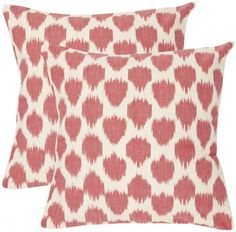 These spotted Ikat pillows pop just the right amount of red into your living room. Nice living room idea! Coastalliving.com