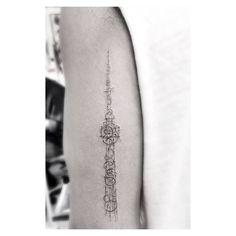 Drake | Toronto's CN Tower on Drake's left tricep. Tattoo artist: Dr. Woo