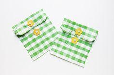 StudioDIY // DIY Flower Envelopes   Favor Bags. Uses readymade paper bag: make something out of heavy paper?