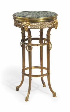 A FRENCH ORMOLU AND GREEN MARBLE GUERIDON 20TH CENTURY