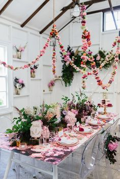 Floral tablescape with hanging floral garlands via Nouba