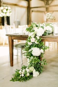 Elegant Southern Farm Wedding in Texas Floral garland with hydrangea, greenery and garden roses. Made by Maxit Flower Design and photographed by Mustard Seed. Wedding Table Centerpieces, Reception Decorations, Table Decorations, Table Wedding, Centerpiece Ideas, Rectangle Table Centerpieces, Wedding Table Garland, White Floral Centerpieces, Quinceanera Centerpieces