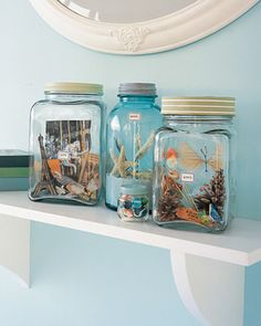 DIY Vacation Memory Jars ~ Filled with souvenirs collected on trips and pictures developed afterward, vacation memory jars are like little worlds that can be visited again and again. Kids can add to them or rearrange them anytime they like. Bent wire can be used to lower and position objects in a thin-necked jar.
