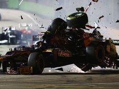 Michael Schumacher crashes into the back of Jean-Eric Vergne's Toro Rosso during the 2012 Singapore GP