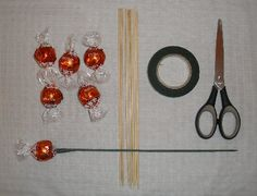 candy bouquet ideas | Prepare Lindt chocolate truffles with red wrappers. To make a candy ...