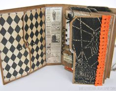Oooo... notice how the file folder (tabs) overlap on the left-hand page... I like the design! (Spider would keep me out of the rest of the book - good for privacy I guess!) - - - Stamptramp: Pop 'n Cuts Mini Halloween Album