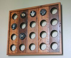Made to order custom hockey puck displays. Any finish or size is available. Please contact me for custom order quotes. The photos provided are examples and will vary due to the nature of reclaimed wood. Any items in the displays are for illustration and are not included. If youve been looking for a unique way to display your collection, consider a display from Grove Woods, made from kiln dried reclaimed lumber.