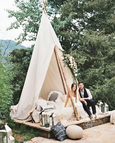 A custom-built teepee filled with comfy blankets and pillows provided a unique lounge area and photo booth backdrop at this bohemian welcome party in Aspen, Colorado.