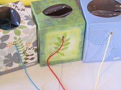 Recycled Tissue Boxes as wool holders - keeps yarn balls organised and free from getting tangled =)