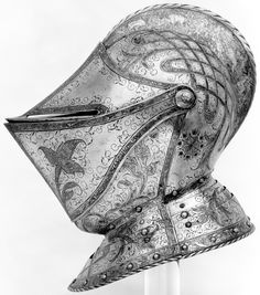 Close helmet, ca. 1560–70, German, Augsburg, steel, etched and gilt, originally part of a complete field armor made for a member of the d'Avalos family, probably Ferrante Francesco d'Avalos (1531–1571), marquis of Vasto, who served the king of Spain as governor of Milan (1560–63), viceroy of Sicily (1568–71), and commander-in-chief of Spanish forces in northern Italy. Wt., 9 lb. (4082 g); H., 13 1/4 in. (33.66 cm); greatest W., 10 in. (25.4 cm); D., 14 1/4 in. (36.2 cm), Met Museum.