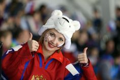 OLY-2014-IHOCKEY-SUI-RUS-WOMEN Sotsi Sotshi Sochi / Venäjä - 15.02.2014 A Russian supporter cheers before the Women's Ice Hockey Play-offs Quarterfinal match between Switzerland and Russia at the Sochi Winter Olympics on February 15, 2014 at the Shayba Arena.   Copyright: AFP / Lehtikuva Lähde: AFP Kuvaaja: Loic Venance February 15, Winter Olympics, Ice Hockey, Switzerland, Cheers, Russia, Fans, Play, Sports