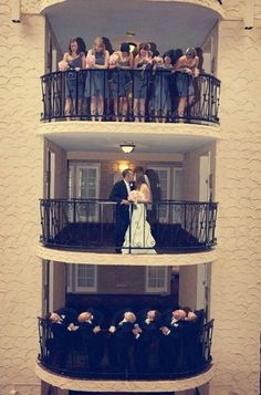 Love this triple-balcony shot with the wedding party | Bellagala Photography