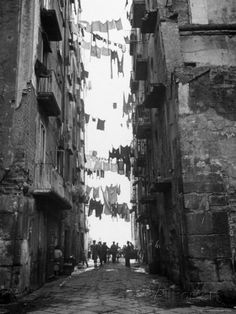 Slum Street with Laundry Hanging Between Buildings Photographic Print by Alfred Eisenstaedt at AllPosters.com