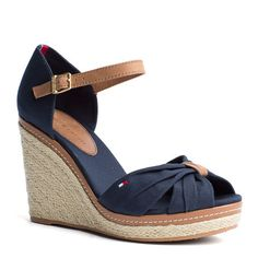 Trendy espadrille wedge sandals. Canvas upper, peep-toe styling with gathered toe strap. Leather ankle strap with branded, gold-toned buckle. Braided jute with leather trim along the wedge for a summertime look. 10.8cm heel. Tommy Hilfiger flag on the outside and the leather patch on the cotton sock lining. Tunit sole.