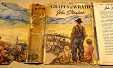 For a very difficult dust jacket repair… I received a dust jacket restoration job for Steinback's The Grapes of Wrath. It was in pieces and had a ton of scotch tape all over the joints and edges of the outside! The front of the dust jacket for The Grapes of Wrath complete with self-adhesive tape to the