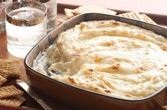 The deep south sure knows how to keep a big crowd happy. Proof? The fact that this ooey gooey cheesy Vidalia Onion Dip exists. Tip: Make a double batch. #recipe #thanksgiving #appetizer