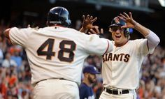 San Francisco Giants' Hunter Pence, right, and Pablo Sandoval (48) celebrate after scoring against the Milwaukee Brewers in the fourth inning of a baseball game Saturday, Aug. 30, 2014, in San Francisco. Both scored on a double by Michael Morse. (AP Photo/Ben Margot)