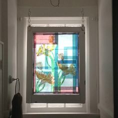 My recent project- Faux stained glass on recycled storm window using tissue paper