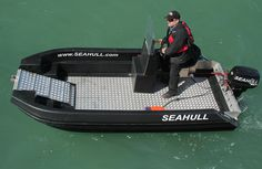 SeaHull cat with drop down front hull access