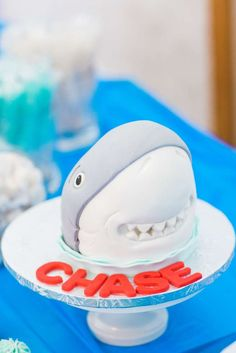 Fun smash cake at a shark birthday party! See more party ideas at CatchMyParty.com!