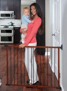 KidCo Designer Angle Mount Safeway Hardware Mount Gate is a metal and wood stairway gate that has high end style without a high end price.  Hardware enables installation on mounting points that are not straight across.  Hinge AND latch side hardware can be mounted on an angle.  Directional stop prevents gate from swinging out over stairs.  G2401 Cherry and Black