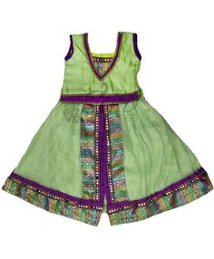 Pista green net lehenga with brocade lining in arundhathi model with brocade blouse. Blouse length- 11 inches, Lehenga length- 17 inches. Both blouse and lehenga has extra fabric of 1-2 inches for size adjustment.  Age- 12 to 18 Months