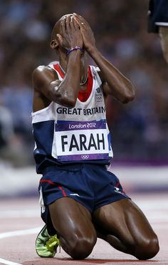 Great Britain's Farah wins Gold in the 10,000 meter.