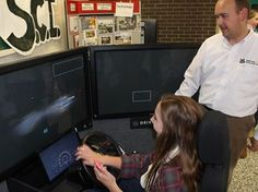 Stayner Collegiate students schooled on distracted driving - Robert Brown attempts to navigate through a virtual streetscape while texting, during a distracted driving awareness event at Stayner Collegiate Institute, Tuesday, Oct. 21, 2014. Ian Adams Photo
