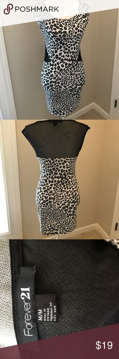 FOREVER 21 black and gray cheetah body con dress FOREVER 21 black and gray animal print body con dress with mesh back and side mesh cuts Forever 21 Dresses Mini