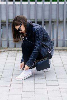 White chucks high tops and black leather