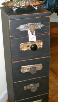Drawer unit with repurposed door knobs and door hardware as drawer pulls. Make from scrap wood or pallet wood. Must do! by carol.rodgers.142