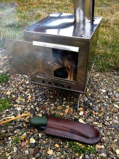 Small breakdown stove and Bahco Laplander saw in sheath.