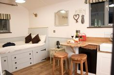 Shepherds Delight is a luxurious, shabby chic shepherds hut, which has a hotel-style bathroom and a fully equipped country-style kitchen, deck and fire pit. Country Style Kitchen, Tiny Spaces, House, Tiny House Interior, Cabins And Cottages, House Interior, Shepherds Hut, Country Cabin, Small Living