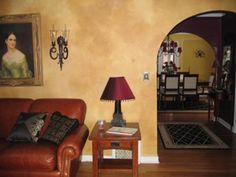 Living room with a Venetian Plaster finish on the walls:  This living room has a base color of Benjamin Moor Aura, #350. The glaze colors are #355 and #370.   The original walls are textured plaster so I just