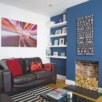 This living room scheme has a masculine feel thanks to its dark blue feature wall, leather sofa and black coffee table. But the look has been kept light by using white on the remaining walls, ceiling and skirting and going for a naturally warm stripped fl Living Room Shelves, Living Room Paint, New Living Room, Living Room Modern, Living Room Designs, Living Room Decor, Dark Blue Feature Wall, Blue Feature Wall Living Room, Dark Blue Walls