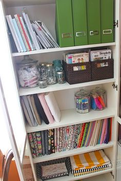 magazine holders for ottobre, large candy jars from walmart for ribbon, ricrac wrapped around popsicle sticks, baskets for patterns