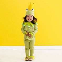 """What you'll need Stiff yellow felt, hot-glue gun, small gold pom-poms, 2 large white pom-poms, black felt, green hat, leggings, and long-sleeve shirt, green felt, medium green pom-poms, scissors, adhesive-backed Velcro.   Make It  Hat Trace template onto a 5""""x10"""" piece of yellow felt, cut out, and glue short sides together to form a crown. Hot-glue gold pom-poms to points of crown and hot-glue to top of hat. Cut two"""