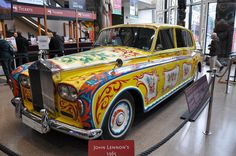 """Lennon bought his Rolls-Royce Phantom V new in '65. Lennon modified the Rolls, adding, fridge & rear bench that turned into a bed. Lennon also had it  painted matte black, odd in '65. Story goes that during """"Sgt. Pepper,"""" Lennon bored of the flat-black color and gave it the psychedelic paint scheme it still has today. Though thought of as an eyesore in the '60s, it eventually fetched almost 2.3 million at an auction in 1985. It now resides in Canada & does the No. Am museum circuit."""