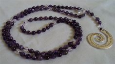 6mm Amethyst with Clear Quartz and Spiral Charm : Hand knotted with purple silk and a spiral charm with a quote about tenderness and strength.  I made 10 of these  exclusive malas for a women's spiritual group