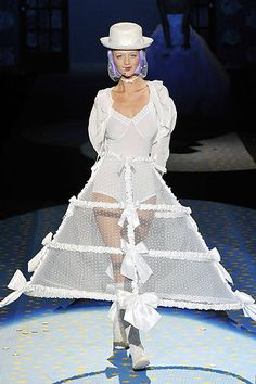 Betsy Johnson Bridal, Skirt is inspired by the caged crinoline it also looks like the sleeve was inspired by the crinoline period because it is fuller.