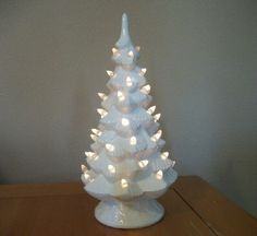 Custom Ceramic Lighted Christmas Tree in White or Color of Choice (45 Color Choices), Christmas Decor, Holiday Gifts, Handmade Vintage by TLCCeramicsIL on Etsy https://www.etsy.com/listing/114536915/custom-ceramic-lighted-christmas-tree-in