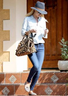 Dressed to impress: Rocking a light denim button-down shirt and a pair of super-skinny indigo jeans which showcased her slim pins to perfect...