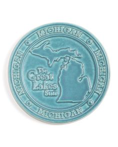 "Pewabic Tileworks This 7"" round tile featuring the Michigan mitten can be used as a trivet, bread warmer, or beautiful art tile to hang on your wall. A great momento or gift for anyone from the Great"